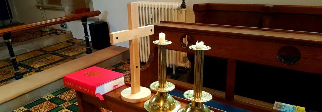 Symbols of faith: a Bible, the Cross, and candles