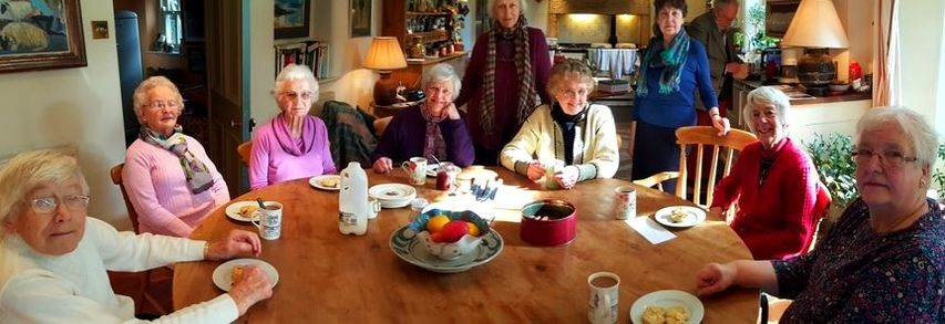 Drop in coffee group round a table